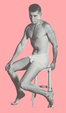 Man in Jockey Shorts on Stool with Pink Background