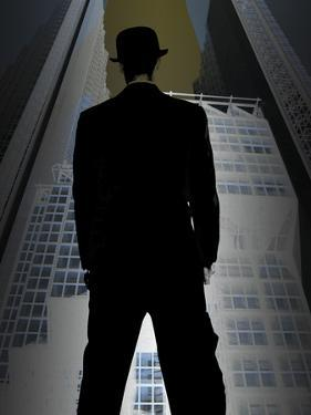 Man in Suit and Bowler Hat Standing in Front of Skyscraper