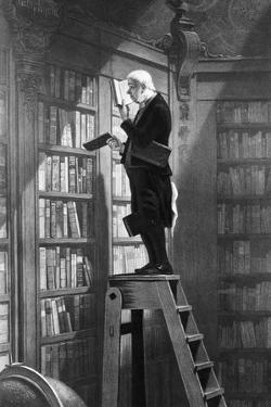 Man Reading on Ladder in Library