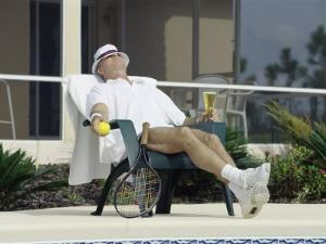 Man Relaxing with a Beer After His Tennis Match