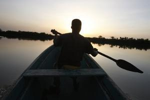 Man rowing on the Casamance river, Ziguinchor, Senegal