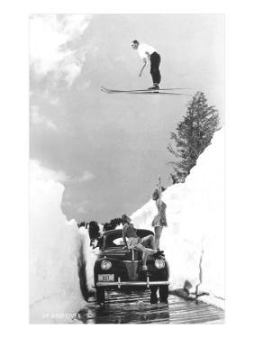 Man Ski-Jumping over Road