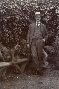 Man with a Bulldog in a Garden