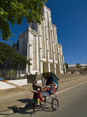 Man With a Rickshaw in Front of a Modern Church in Mahajanga, Madagascar, Africa