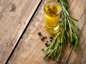 Cooking Oil and Fresh Rosemary by manera