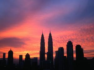 City Skyline at Sunrise Dominated by Petronas Twin Towers, Kuala Lumpur, Malaysia by Manfred Gottschalk