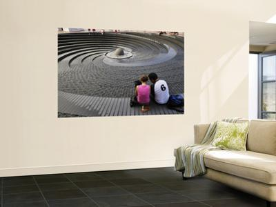 Couple Looking at the Spiral Fountain at the Sydney Convention Centre, Darling Harbour