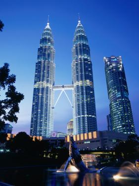 Petronas Twin Towers in Evening Light, Kuala Lumpur, Malaysia by Manfred Gottschalk