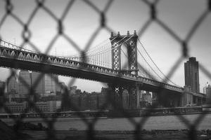 Manhattan Bridge in Black and White Through Chain Fence