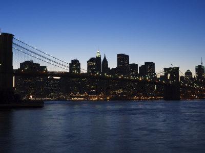 https://imgc.allpostersimages.com/img/posters/manhattan-skyline-and-brooklyn-bridge-at-dusk-new-york-city-new-york-usa_u-L-P1KCKT0.jpg?p=0