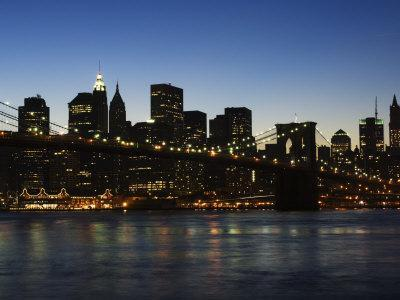 https://imgc.allpostersimages.com/img/posters/manhattan-skyline-and-brooklyn-bridge-at-dusk-new-york-city-new-york-usa_u-L-P1KCO20.jpg?p=0