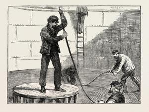 Manufacturing an Electric Telegraph Cable: Coiling Down the Cable in the Tank, 1873
