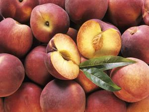 Many Whole Peaches with One Halved