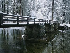 A Snow-Covered Footbridge Spanning the Merced River by Marc Moritsch