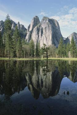 Cathedral Rocks and Reflection on the Surface of Still Water by Marc Moritsch