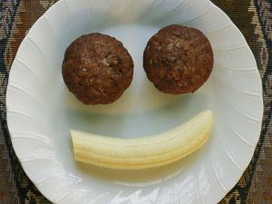 Smiling Breakfast of Muffins and a Banana by Marc Moritsch