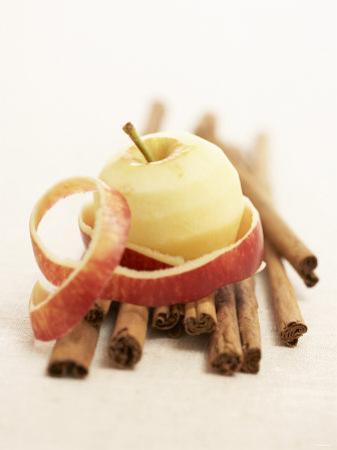 A Peeled Apple on Cinnamon Sticks by Marc O. Finley