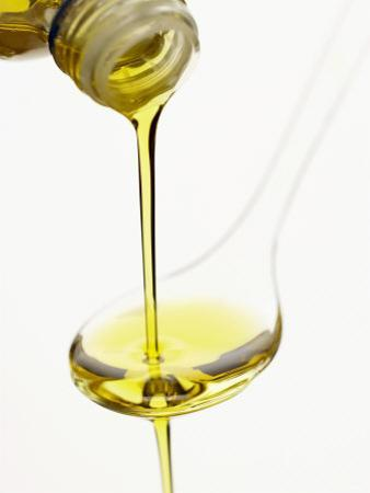 Pouring Olive Oil Over a Spoon by Marc O. Finley