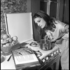 Dalida Ccooking in Her Kitchen by Marcel Begoin