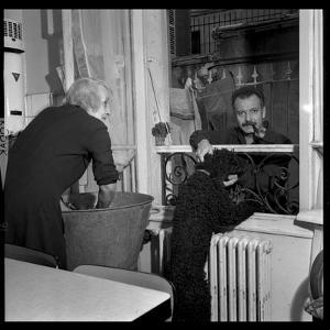Georges Brassens Playing the Guitare at Home by Marcel Begoin
