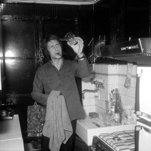 Jacques Dutronc Washing a Glass and Smoking a Cigar in 1972 by Marcel Roldes
