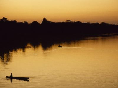 People in Canoes on the Calm Waters of the Amazon River, Amazon River, Colombia and Peru