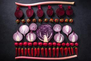 Red Vegetables Cut in Halves, Flat Lay Design on Dark Background, Symmetric by Marcin Jucha