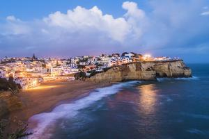 Carvoeiro, Lagoa, Algarve, Portugal. City lights at dusk. by Marco Bottigelli