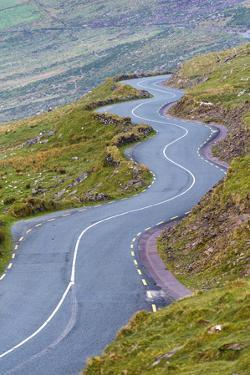 Connor pass, Dingle peninsula, County Kerry, Munster province, Ireland, Europe.  Bending road leadi by Marco Bottigelli