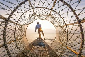 Inle lake, Nyaungshwe township, Taunggyi district, Myanmar (Burma). Local fisherman with typical co by Marco Bottigelli