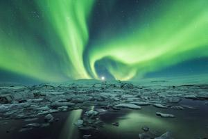 Jokulsarlon, East Iceland, Iceland. Northern lights over the glacier lagoon. by Marco Bottigelli