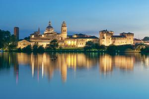 Mantova, Lombardy, Italy. Mincio's Banks with Historical Buildings at Sunset. by Marco Bottigelli