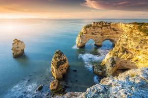 Praia de Marinha, Caramujeira, Lagoa, Algarve, Portugal. Coastal rock formations at sunrise. by Marco Bottigelli