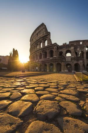 Rome, Lazio, Italy. Colosseum at Summer Sunrise. by Marco Bottigelli