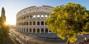 Rome, Lazio, Italy. High angle panoramic view over the Colosseum square at sunrise. by Marco Bottigelli