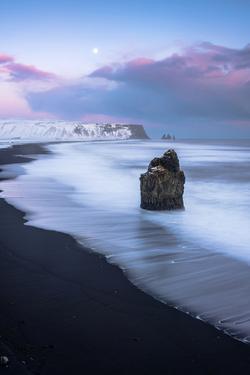 Vik, Southern Iceland, Europe.  The black beach of Reynisfjara on a winter sunset. by Marco Bottigelli