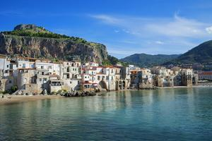 Traditional fishing boats and fishermens houses, Cefalu, Sicily, Italy, Europe by Marco Simoni
