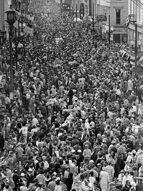 Mardi Gras Revelers Gather at St. Charles Street