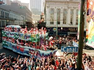 Mardi Gras Revellers Greet a Float from the Zulu Parade