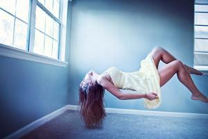 Female Floating in Room by Maren Kathleen Slay