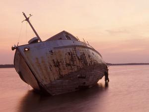 Sunrise on Fishing Boat Washed Ashore During Hurricane Opal, Pensacola Bay, Florida, USA by Maresa Pryor