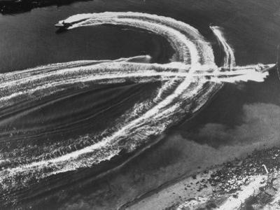Aerial View of Waterskiers and Motorboats Speeding across the Pacific Ocean at Marine Stadium by Margaret Bourke-White