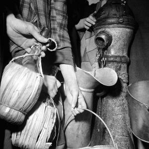 Civilians Filling Wine Jugs with Fresh Water after City was Restored in the Wake of Germans, WWII by Margaret Bourke-White