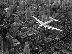 Douglas 4 Flying over Manhattan by Margaret Bourke-White