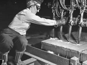 Female Steel Worker Operating Four Torch Machine to Cut Large Slab of Steel at Mill by Margaret Bourke-White