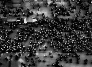 Overhead View of Men Relaxing on 36th Street, Between Eighth and Ninth Aves. by Margaret Bourke-White