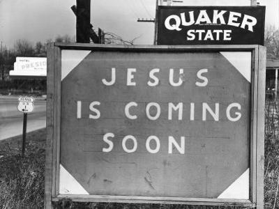 Penna US 1 Highway Sign Left of Quaker State Sign Looming Above Jesus is Coming Soon Billboard by Margaret Bourke-White