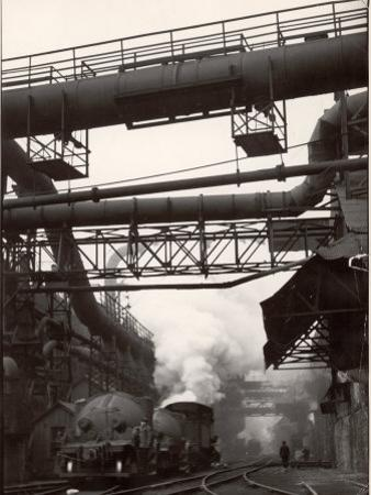 Steaming Hot Steel Slag Being Poured into Freight Cars on Railroad Siding at Steel Plant by Margaret Bourke-White