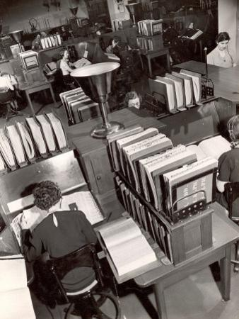 Telephone Operators Consulting Local and Long Distance Books and Directories, New York Telephone Co by Margaret Bourke-White