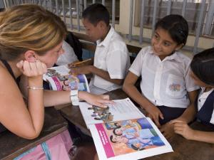 German Volunteer Helping Children with School Work, el Pochote, Near Granada, Granada, Nicaragua by Margie Politzer
